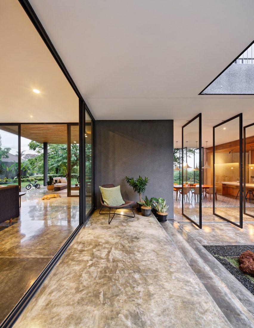 tamara wibowo's Pivoting doors offer breezes and views at Tamara Wibowo's Indonesian home pivoting doors offer breezes views tamara wibowos indonesian home 5