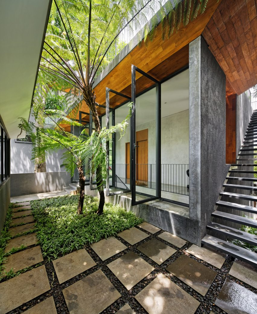 Tamara Wibowo's tamara wibowo's Pivoting doors offer breezes and views at Tamara Wibowo's Indonesian home pivoting doors offer breezes views tamara wibowos indonesian home 7
